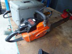 Orange petrol powered chainsaw