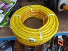 Small roll of yellow hose