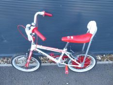 Red and white One Direction child's cycle