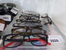 8 Various designer glasses frames to include, Emporio Armani, Radley etc