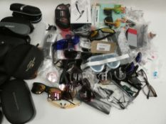 Bag containing quantity of various sunglasses and reading glasses plus bag of cases