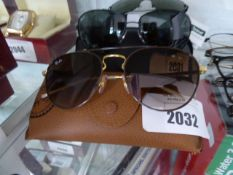 Pair of ray ban sunglasses with hard carry case model number RB3589