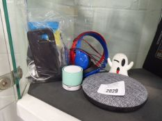 Selection of electrical items to include ghost shaped power bank, blue tooth speaker, mobile phone