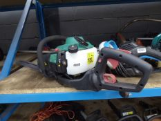 Green petrol powered hedge cutter