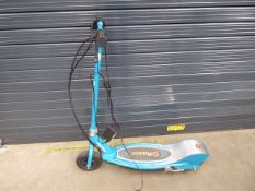 Green Razor electric scooter with charger