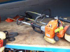 Castor orange petrol powered strimmer