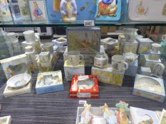 Approximately 30 Peter Rabbit by Wedgwood collectable ceramics to include various cups,
