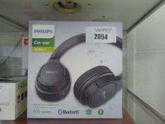 Philips on ear Action Fit bluetooth headset in box