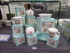 15 boxed Royal Doulton Beatrix Potter themed collectable items in porcelain to include cups, money