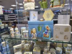 Various Beatrix Potter themed Peter Rabbit money boxes, collectible tins, cases, etc (proceeds of