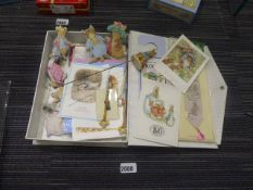 Tray containing various Beatrix Potter collectable badges, fabric figures, bobbins, postcards,