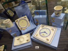 11 or more Wedgwood collectable Beatrix Potter ceramic items to include wall clock, money box,
