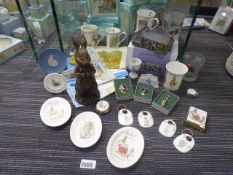 Approximately 20 or more Beatrix Potter collectable items to include badges, tags, porcelain