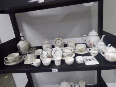 Shelf containing a selection of Beatrix Potter collectable porcelain items by Wedgwood to include
