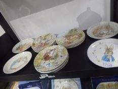 Approximately 16 collector's plates to include ones by Wedgwood themed as Beatrix Potter