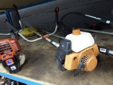 Orange petrol-powered brushcutter