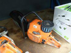 Orange petrol-powered disc cutter