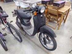 Honda black 50cc moped