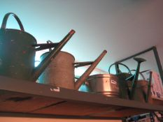 4 vintage watering cans with Bitburger pot
