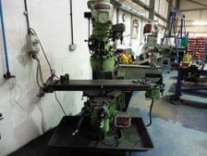 Bridgeport Turret Milling Machine with a powered Table size 9'' x 48'' Serial number 243951176LX