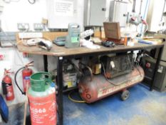 Welded metal workbench with plywood top, 8' wide approx (excluding contents)