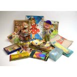 A mixed group of toys including a battery operated feeding monkey, puzzles,