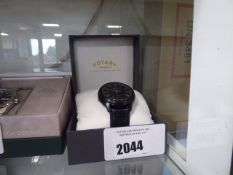 Rotary leather strapped black faced Roman numeral dial wrist watch with box