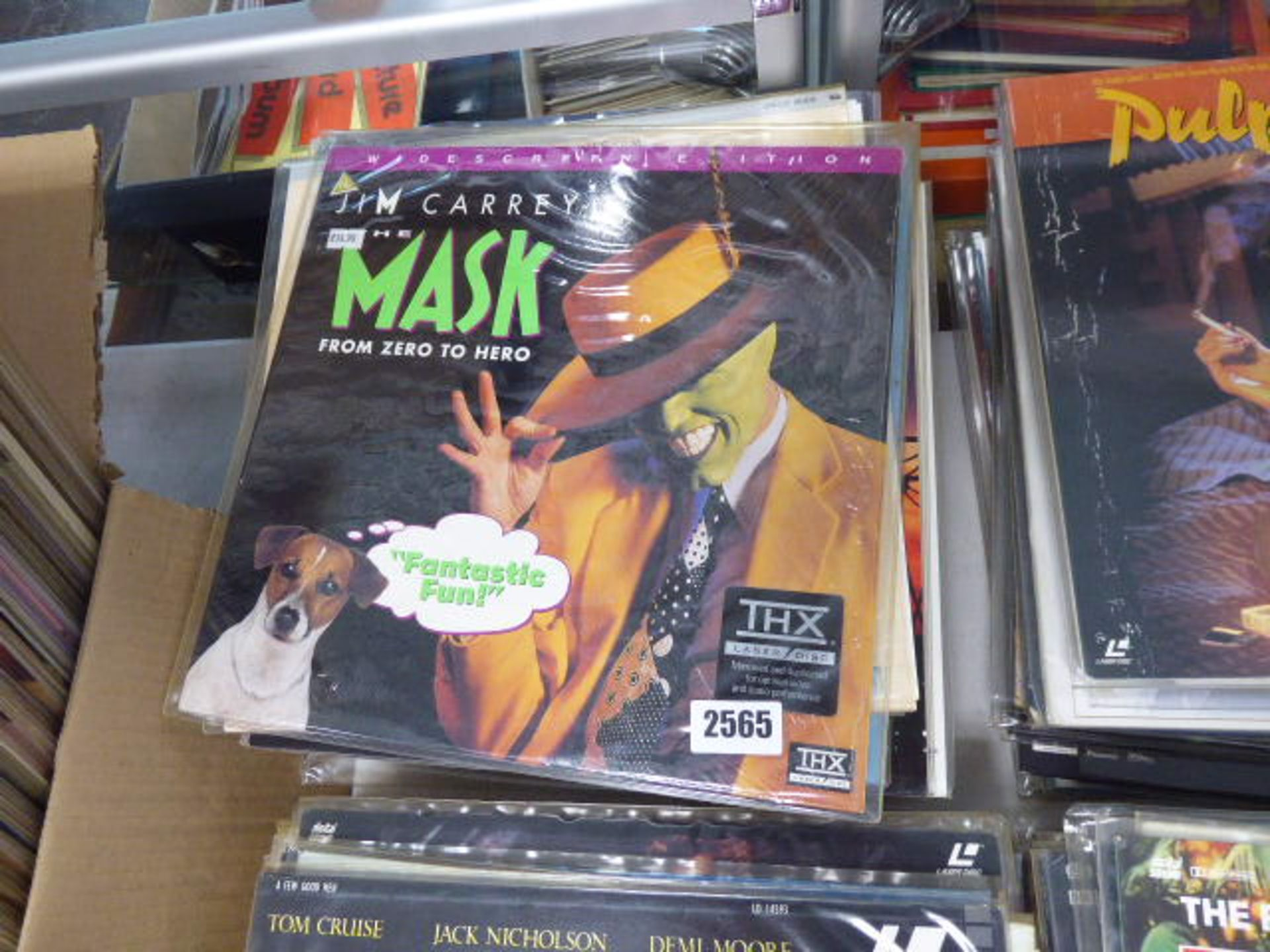 Lot 2565 - Approx 20 or more laser disk movies to inc. Jim Carey's The Mask, Uncle Buck, Never Ending Story and