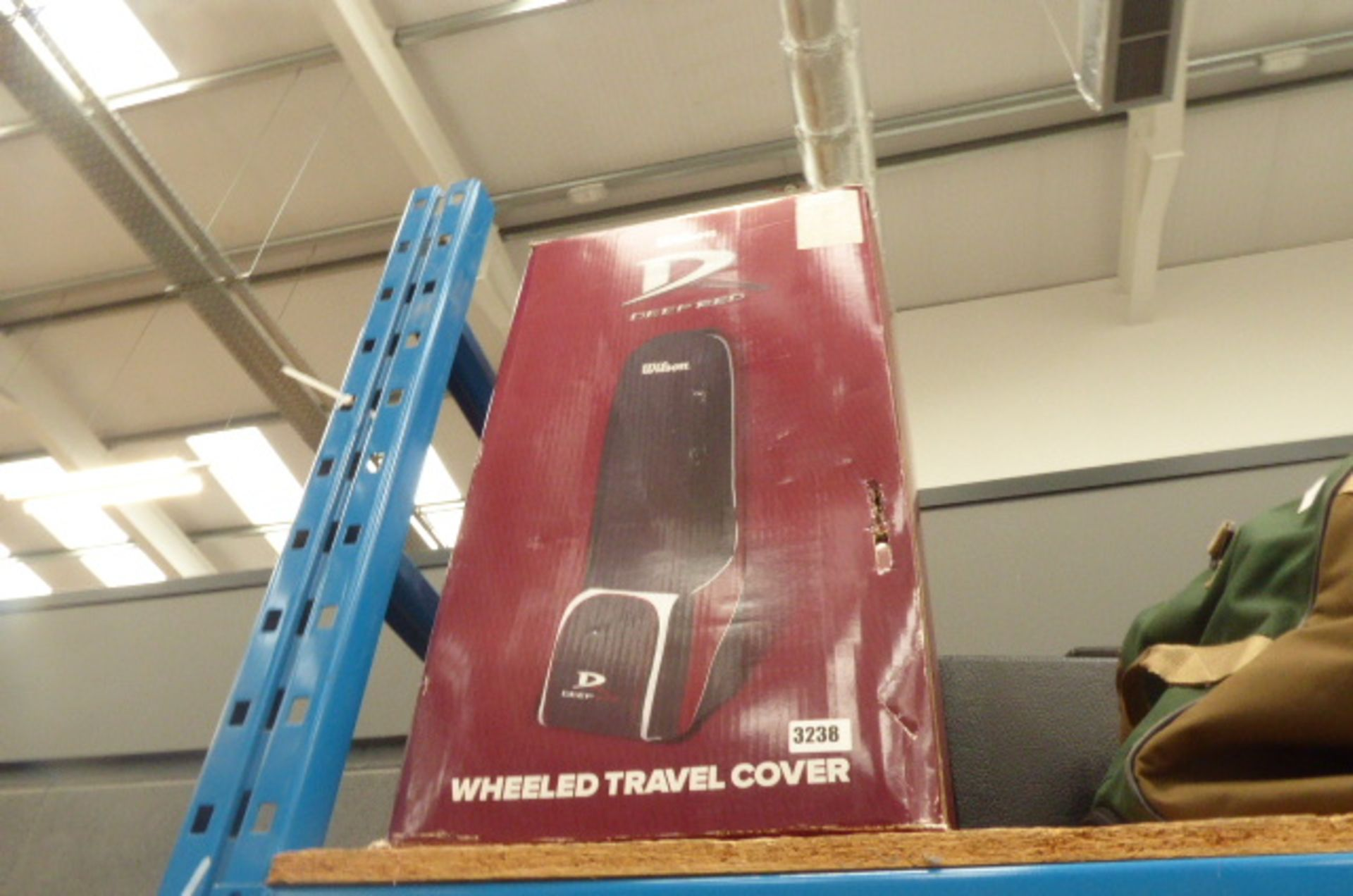 Lot 3238 - Boxed Wilson wheeled travel cover