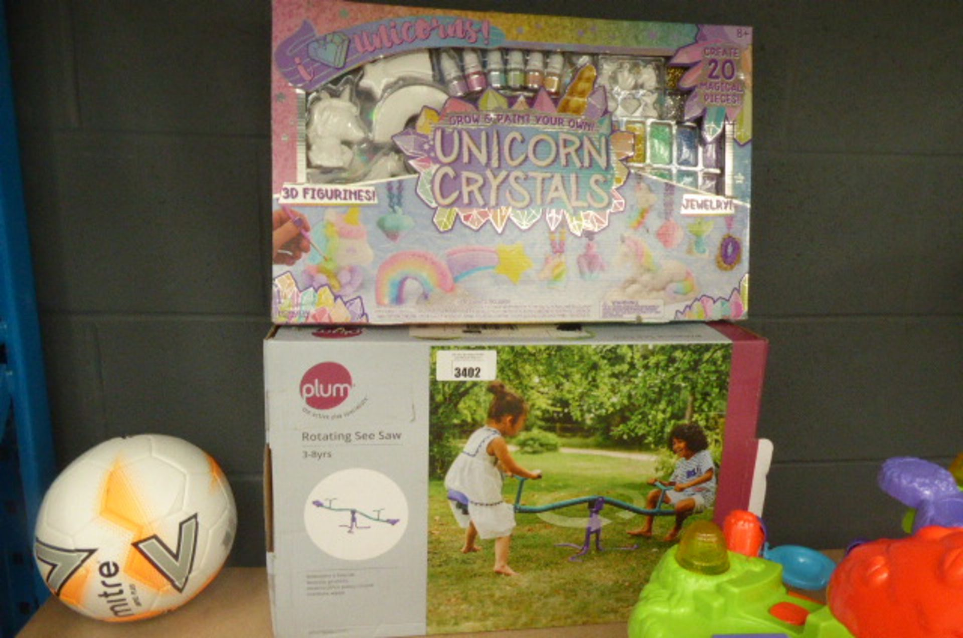 Lot 3402 - A rotating seesaw and a Unicorn Crystal set