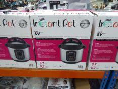 (82) Boxed instant pot multi use pressure cooker