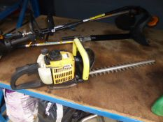 Landscape yellow petrol powered hedge cutter