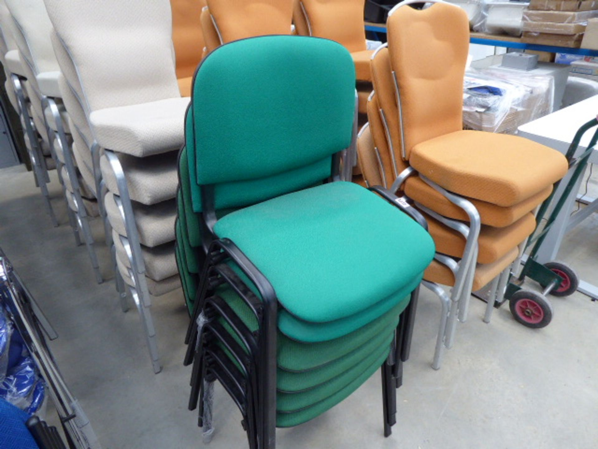Lot 4238 - 6 green cloth stacking chairs