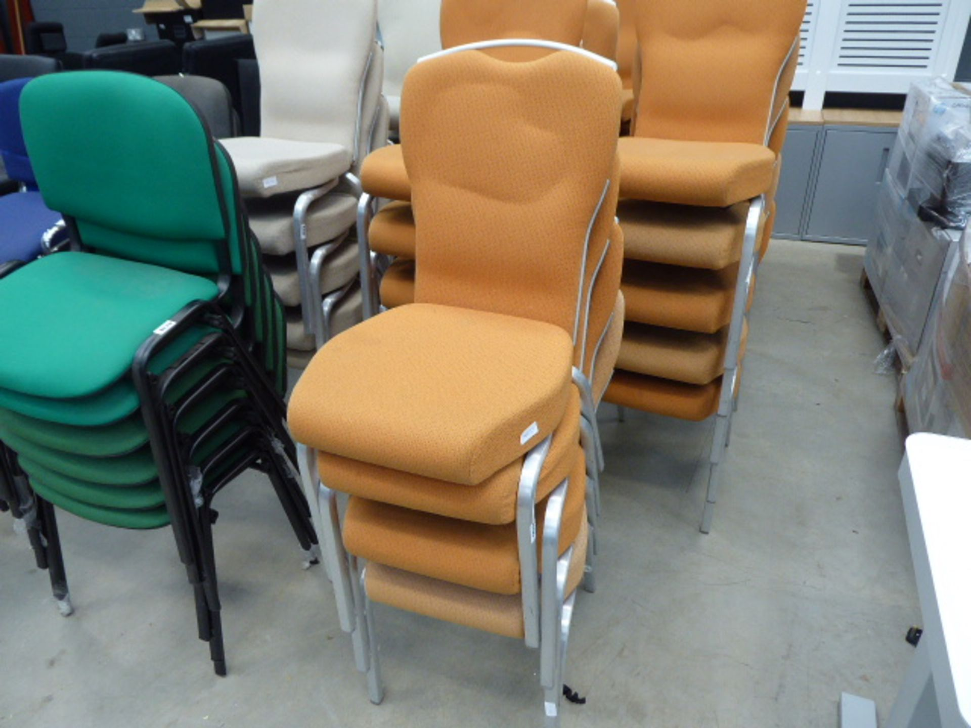 Lot 4236 - 4 orange cloth metal framed stacking chairs