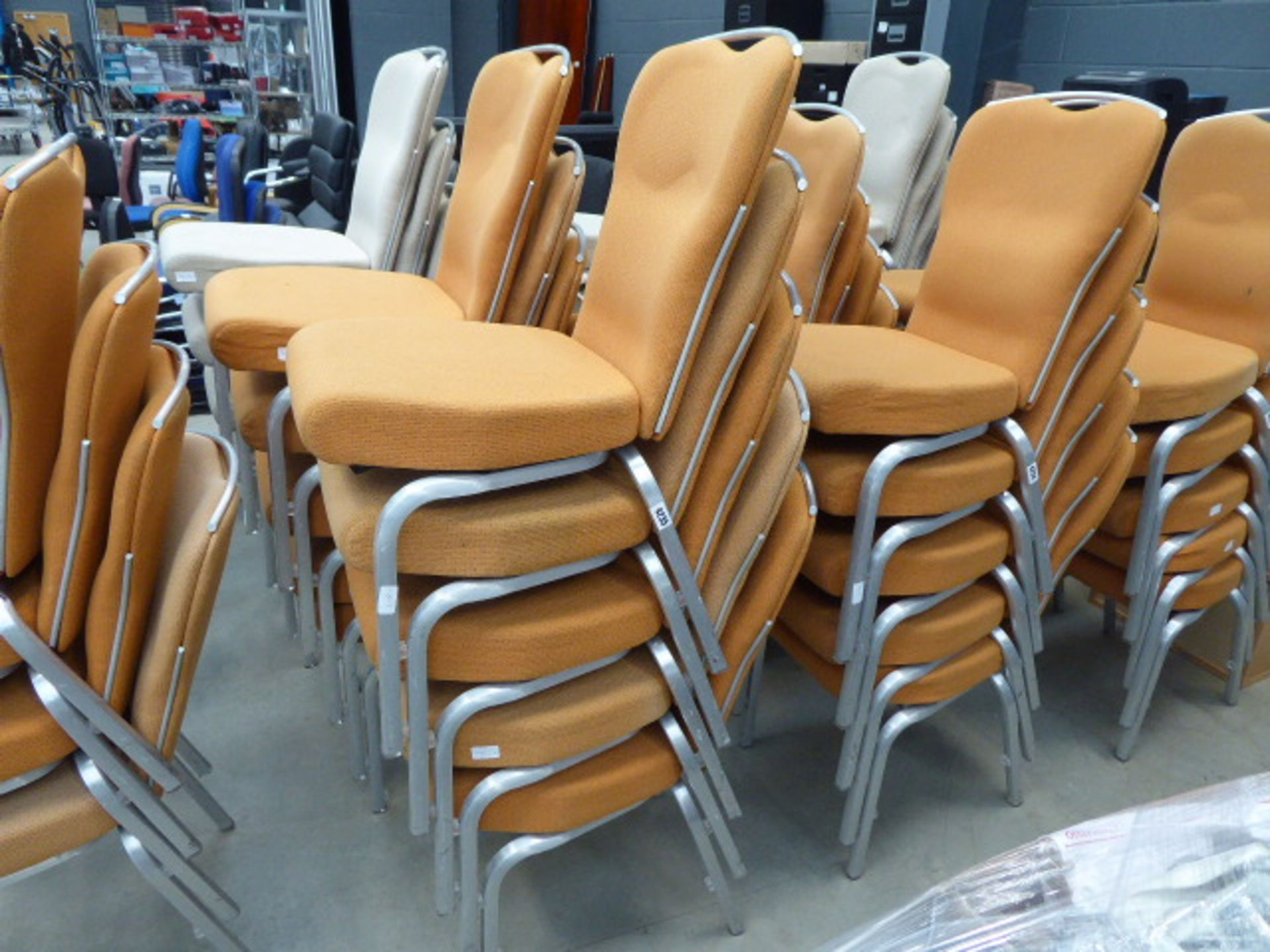 Lot 4235 - 10 orange cloth metal framed stacking chairs