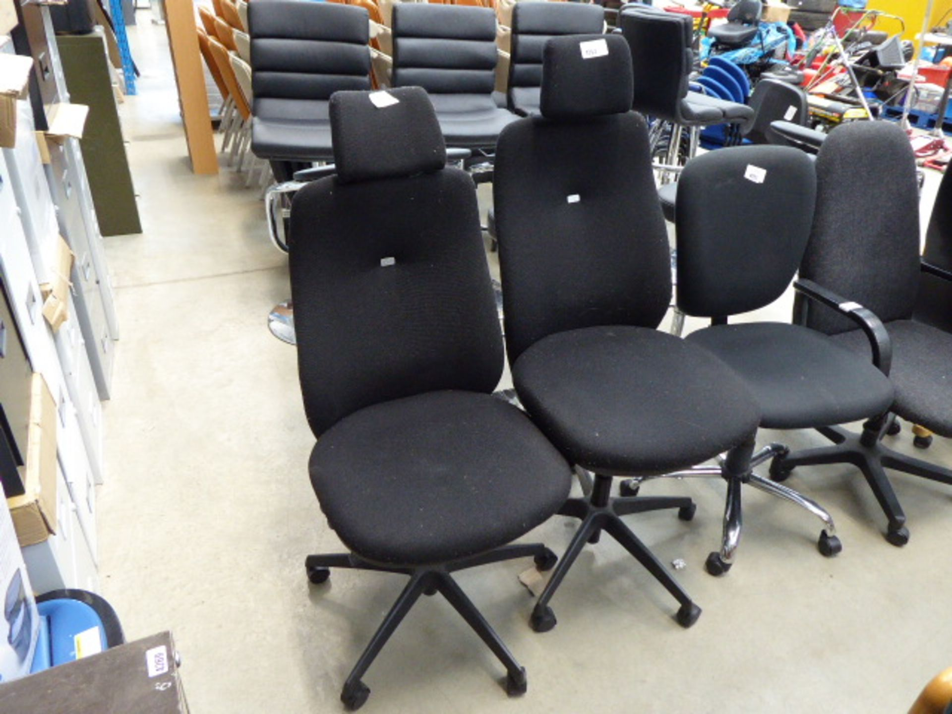 Lot 4253 - 2 black cloth high backed swivel chairs