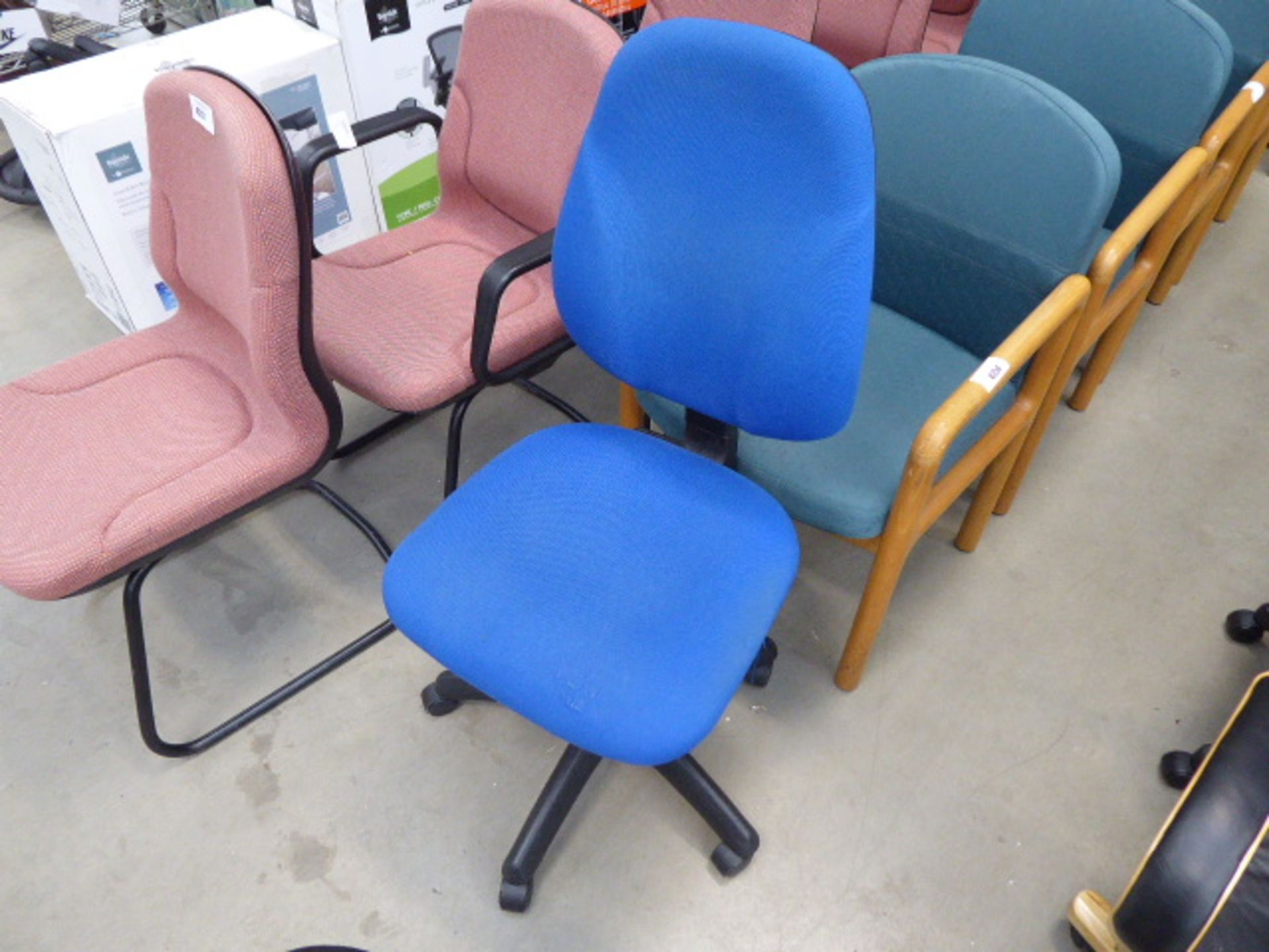 Lot 4255 - Blue cloth swivel chair