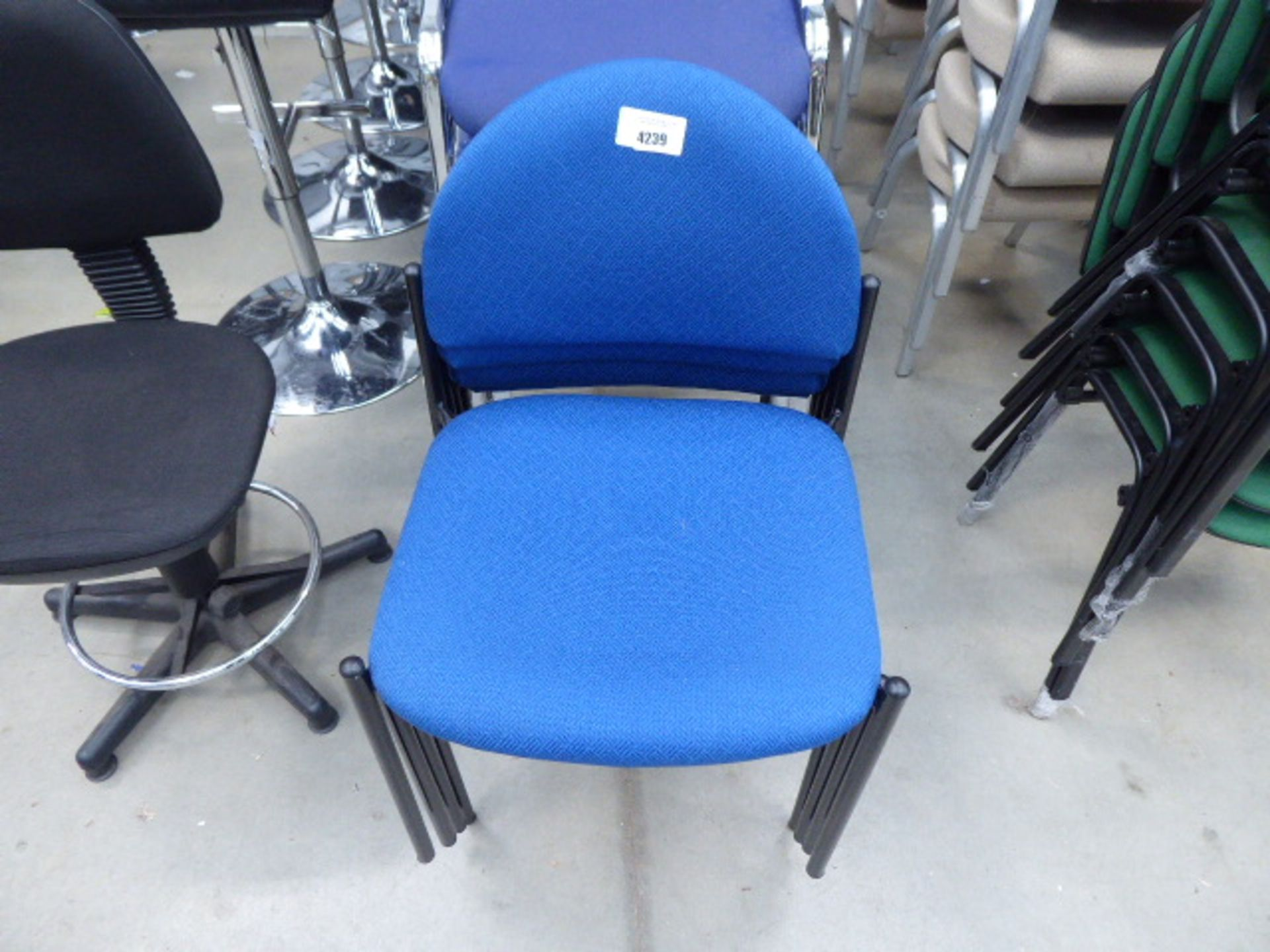 Lot 4239 - 4 blue cloth stacking chairs