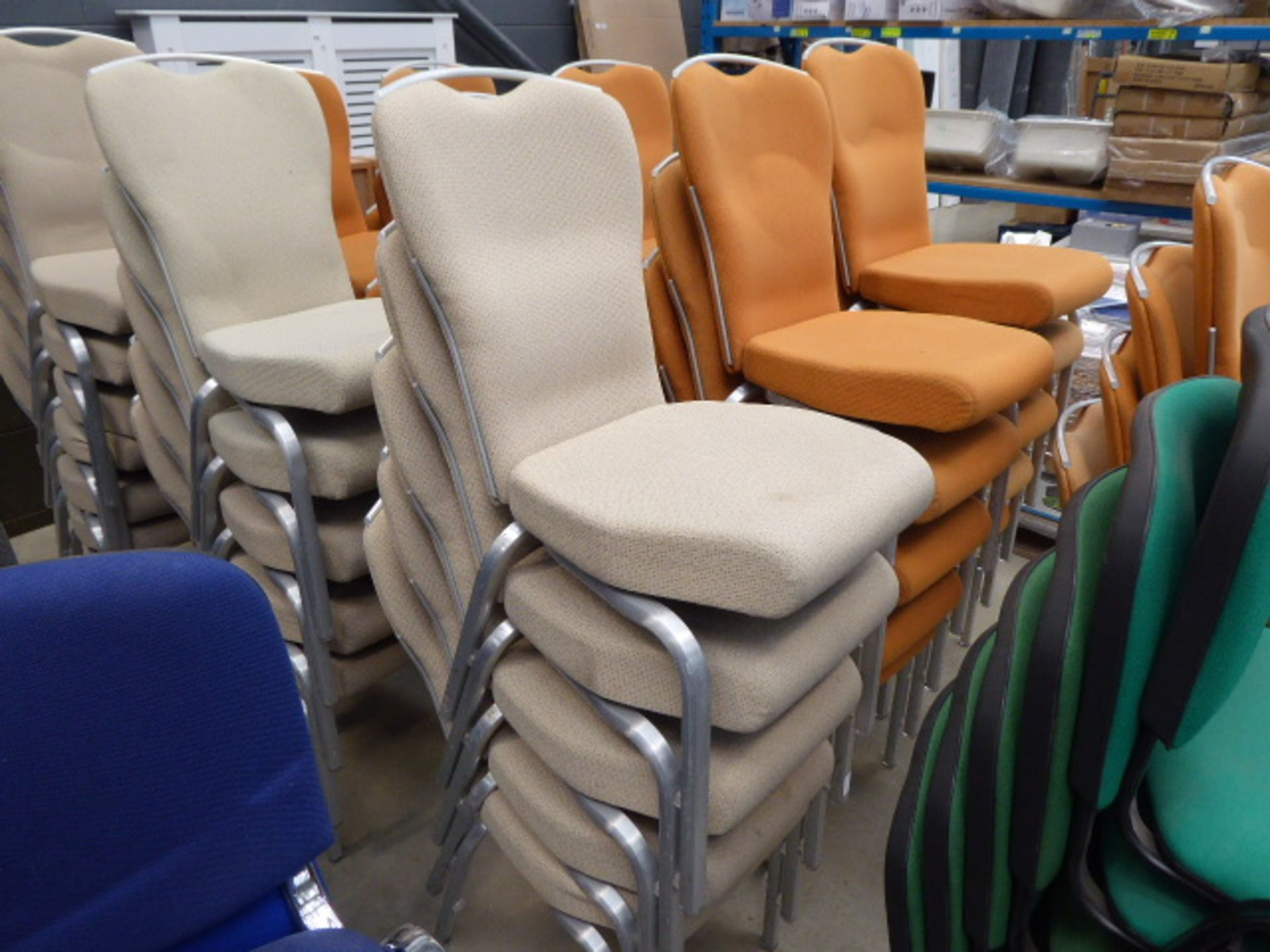 Lot 4237 - 15 beige cloth metal framed stacking chairs