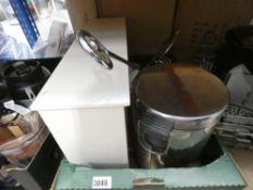 Tray containing small pedal bin, wall mounted shelf, tec