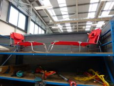 Pair of red cloth and aluminium folding sun loungers