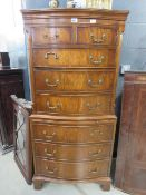 Dark wood chest on chest of 2 over 6 drawers