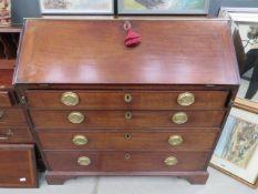 Large dark wood bureau of 4 drawers with brass banding