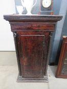 Dark wood single door plinth cupboard with barley twist supports