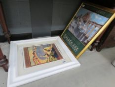 2 assorted framed and glazed travel posters