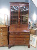 Dark wood bookcase over bureau
