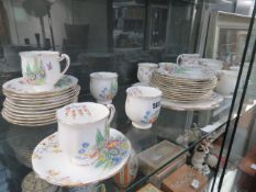 Shelf of standard china decorated with flowers