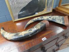 Pair of carved horns carved with tigers and birds