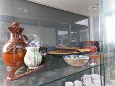 Shelf of assorted stone glazed pottery