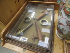 Framed display frame of brass and brewery taps